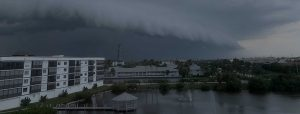 storm over white building